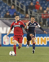 Chicago Fire defender Dan Gargan (3) brings the ball forward as New England Revolution forward Benny Feilhaber (22) defends. In a Major League Soccer (MLS) match, the New England Revolution defeated Chicago Fire, 2-0, at Gillette Stadium on June 2, 2012.