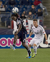 New England Revolution midfielder Shalrie Joseph (21) heads the ball. In a Major League Soccer (MLS) match, the New England Revolution defeated the Vancouver Whitecaps FC, 1-0, at Gillette Stadium on May14, 2011.