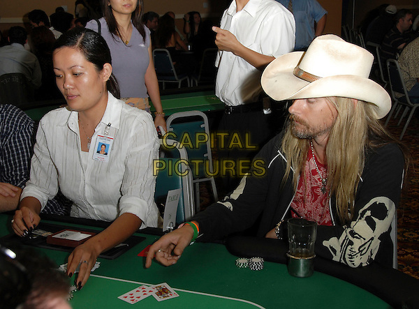 GUEST.attends The Celebrity Poker Tournament benefitting The Los Angeles Youth Network held at The Crystal Casino in Comton, LA, California, USA, September 9th 2006..half length sitting at poker table.Ref: DVS.www.capitalpictures.com.sales@capitalpictures.com.©Debbie VanStory/Capital Pictures