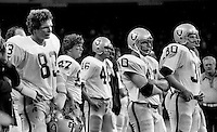 Oakland Raiders sideline after loss..Ted Hendricks, Dave Casper, Pete Banazak, and Mark van Eeghen.<br />(1978 photo by Ron Riesterer)