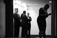Washington, DC - May 1, 2016: Secret Service agents wait for Sen. Bernie Sanders to arrive for a news conference in the ballroom of the National Press Club in the District of Columbia, May 1, 2016, as Sanders' national press secretary, Symone Sanders (r) works on her phone. On this day, Sen. Sanders trails former Secretary of State Hillary Clinton in the delegate count for the 2016 Democratic presidential nomination.  (Photo by Don Baxter/Media Images International)