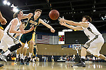 RAPID CITY, SD - FEBRUARY 24, 2016 -- Fraser Malcom #24 of Black Hills State reaches for a loose ball with Konor Kulas #14 and Philip Schanilic #3 of South Dakota Mines during their college basketball game Wednesday at the Rushmore Plaza Civic Center Ice Arena, S.D.  (Photo by Dick Carlson/Inertia)