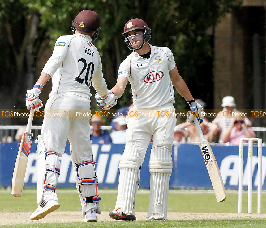 Jason Roy congratulates Rory Burns (right) on scoring his fifty runs.