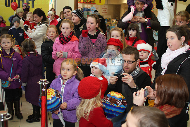 as Santa arrives at the Town Centre...(Photo credit should read Jenny Matthews www.newsfile.ie)....This Picture has been sent you under the conditions enclosed by:.Newsfile Ltd..The Studio,.Millmount Abbey,.Drogheda,.Co Meath..Ireland..Tel: +353(0)41-9871240.Fax: +353(0)41-9871260.GSM: +353(0)86-2500958.email: pictures@newsfile.ie.www.newsfile.ie.