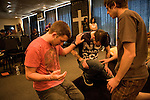 HURST, TEXAS, MAY 2, 2010 : Sunday worship at the Deliverance Bible Church (DBC) in Hurst, Texas, led by Pastor Cleetus Adrian and his wife Nicole. DBC is a nondenominational Church with a punk-hardcore flavor: Heavy metal guitar, pounding drums, guttural lyrics and a tattooed pierced pastor leading the worship . .DBC is part of a growing nationwide movement in american christianity called the Christian Underground . Its youth oriented brand of worship appeals to social outcasts from the punks and hardcore underground. .