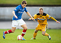 Cowdenbeath's Greg Stewart tires to get past Dumbarton's Scott Agnew   ...