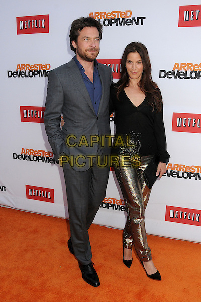 "Jason Bateman, Amanda Anka.""Arrested Development"" Season 4 Los Angeles Premiere held at the TCL Chinese Theatre, Hollywood, California, USA..April 29th, 2013.full length suit black top gold trousers married husband wife shirt beard facial hair blue grey gray .CAP/ADM/BP.©Byron Purvis/AdMedia/Capital Pictures"