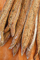 Freshly-baked multigrain French bread baguettes on sale at food market in Bordeaux region of France