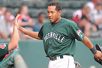 Infielder Heiker Meneses (21) of the Greenville Drive is congratulated after scoring a run in a game against the Lexington Legends on June 5, 2011, at Fluor Field at the West End in Greenville, S.C. Photo by Tom Priddy / Four Seam Images