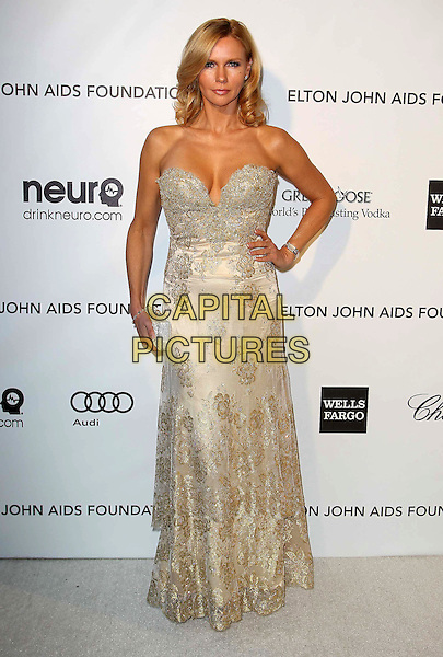 Veronika Ferres.The 21st Annual Elton John AIDS Foundation Academy Awards Viewing Party held at The City of West Hollywood Park in West Hollywood, California, USA..February 24th, 2013.oscars full length dress gold beads beaded hand on hip cleavage .CAP/ADM/KB.©Kevan Brooks/AdMedia/Capital Pictures.