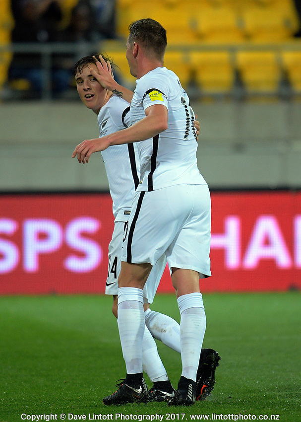 Shane Smeltz congratulates Ryan Thomas on his opening goal during the 2018 FIFA World Cup Russia qualifying match between the NZ All Whites and Fiji  at Westpac Stadium in Wellington, New Zealand on Tuesday, 28 March 2016. Photo: Dave Lintott / lintottphoto.co.nz