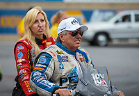 Sep 14, 2018; Mohnton, PA, USA; NHRA funny car driver John Force (right) with daughter Courtney Force during qualifying for the Dodge Nationals at Maple Grove Raceway. Mandatory Credit: Mark J. Rebilas-USA TODAY Sports