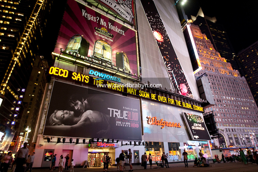 """The Dow Jones electronic news ticker on Times Square in New York, USA, 25 June 2009, displays a message that reads """"the worst may soon be over"""" in reference to the conclusion of an OECD analysis of the global economy."""