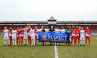 Both teams pose with officials pre match with the UEFA RESPECT banner during the UEFA Youth League round of 16 match between Tottenham Hotspur U19 and Monaco at Tottenham Hotspur Training Ground, Hotspur Way, England on 21 February 2018. Photo by Andy Rowland.