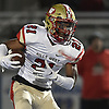 Deyvon Wright #21 of Half Hollow Hills West rushes for a gain during the second quarter of the Class III Long Island Championship against Plainedge at Shuart Stadium in Hempstead on Saturday, Nov. 24, 2018.