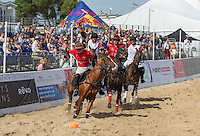 Roddy Matthews of Wales attacks during the Wales v England match at the Asahi Beach Polo Championship  at Sandbanks, Poole, England on 10 July 2015. Photo by Andy Rowland.