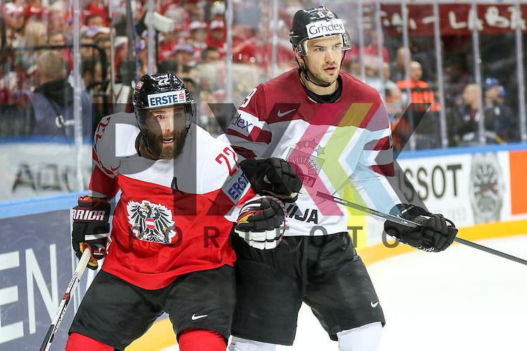 Lativa Redlihs, Krisjanis (Nr.9) im Zweikampf mit Oestereichs Petrik, Nicolas (Nr.22)  im Spiel IIHF WC15 Oestereich vs. Lativa.<br /> <br /> Foto &copy; P-I-X.org *** Foto ist honorarpflichtig! *** Auf Anfrage in hoeherer Qualitaet/Aufloesung. Belegexemplar erbeten. Veroeffentlichung ausschliesslich fuer journalistisch-publizistische Zwecke. For editorial use only.