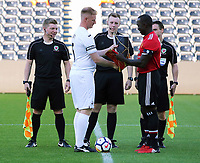 Alan Tate of Swansea Legends exchanges gifts with the Manchester United Legends captain during the Swansea City Legends v Manchester United Legends at the Liberty Stadium, Swansea, Wales, UK