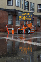 """A temporary sign reads """"Puede Hacer La Diferencia"""" (""""You can make a difference"""") during the ongoing Coronavirus (COVID-19) global pandemic in Chelsea, Massachusetts, on Mon., April 27, 2020. Chelsea, Mass., is one of the hardest hit communities in Massachusetts with high infection and death rates. As much as 80% of the population works in so-called """"essential jobs,"""" meaning that they continue to work during shelter-in-place orders."""