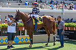DEL MAR, CA  AUGUST 4:  Drayden Van Dyke aboard #4 Tap the Wire, and the connections in the winners circle after winning the Graduation Stakes on August 4, 2018 at Del Mar Thoroughbred Club in Del Mar, CA.