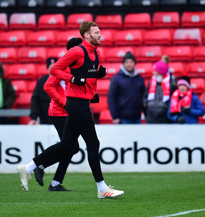 Lincoln City's Cian Bolger during the pre-match warm-up<br /> <br /> Photographer Andrew Vaughan/CameraSport<br /> <br /> The EFL Sky Bet League Two - Lincoln City v Grimsby Town - Saturday 19 January 2019 - Sincil Bank - Lincoln<br /> <br /> World Copyright &copy; 2019 CameraSport. All rights reserved. 43 Linden Ave. Countesthorpe. Leicester. England. LE8 5PG - Tel: +44 (0) 116 277 4147 - admin@camerasport.com - www.camerasport.com