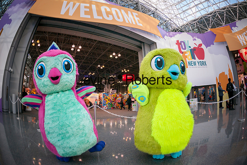 Characters dressed as Hatchimals welcome attendees at the 114th North American International Toy Fair in the Jacob Javits Convention center in New York on Sunday, February 19, 2017.  The four day trade show with over 1000 exhibitors connects buyers and sellers and draws tens of thousands of attendees.  The toy industry generates over $26 billion in the U.S. alone and Toy Fair is the largest toy trade show in the Western Hemisphere. (© Richard B. Levine)