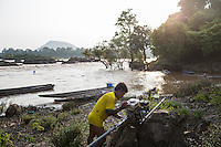 Oct. 10, 2016 - Don Sahong, Laos. A fisherman rests his boat engine near the Mekong River. © Nicolas Axelrod / Ruom