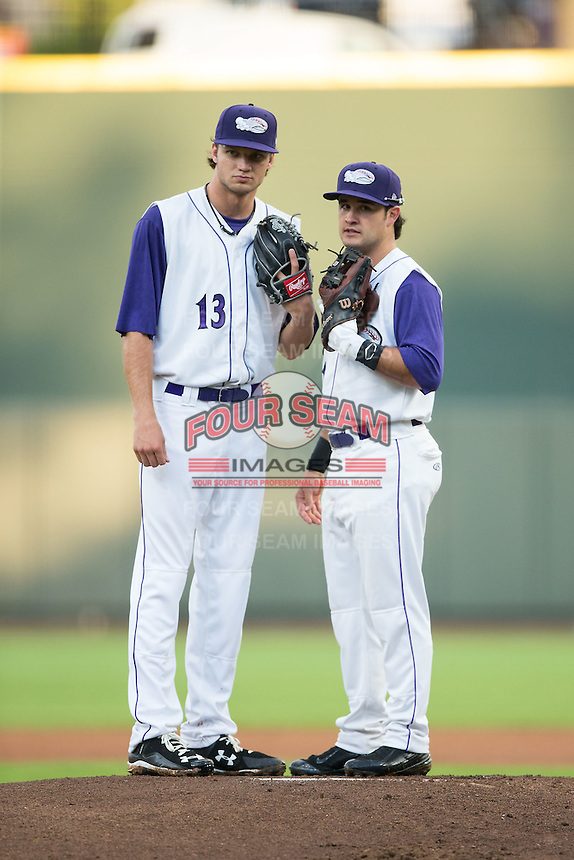 Winston-Salem Dash second baseman Eddy Alvarez (1) chats with starting pitcher Spencer Adams (13) during the game against the Myrtle Beach Pelicans at BB&T Ballpark on August 20, 2015 in Winston-Salem, North Carolina.  The Dash defeated the Pelicans 5-4 on a walk-off wild pitch in the bottom of the 9th inning.  (Brian Westerholt/Four Seam Images)