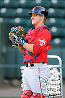 Catcher Jake Romanski (12) of the Greenville Drive works out on the team's Media Day first workout on Tuesday, April 1, 2014, at Fluor Field at the West End in Greenville, South Carolina. (Tom Priddy/Four Seam Images)