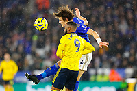 9th November 2019; King Power Stadium, Leicester, Midlands, England; English Premier League Football, Leicester City versus Arsenal; Caglar Soyuncu of Leicester City heads clear under pressure from Alexandre Lacazette of Arsenal - Strictly Editorial Use Only. No use with unauthorized audio, video, data, fixture lists, club/league logos or 'live' services. Online in-match use limited to 120 images, no video emulation. No use in betting, games or single club/league/player publications