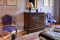 Antique chest of drawers in a guest bedroom in the Chateau de la Bourlie, Dordogne