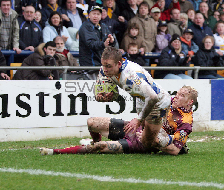 PICTURE BY VAUGHN RIDLEY/SWPIX.COM -  Rugby League - Super League - Leeds Rhinos v Huddersfield Giants - Headingley, Leeds, England - 04/03/07...Copyright - Simon Wilkinson - 07811 267706...Huddersfield's Paul Reilly tries to stop Leeds Lee Smith from scoring a try.