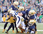 Sept. 19, 2015; The Notre Dame defense makes a tackle in the fourth quarter against Georgia Tech. Notre Dame won 30-22. (Photo by Matt Cashore)