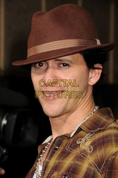 "CLIFTON COLLINS JR..""Machete"" Los Angeles Premiere held at the Orpheum Theatre, Los Angeles, California, USA, 25th August 2010. .portrait headshot brown plaid hat shirt necklace checked check .CAP/ADM/BP.©Byron Purvis/AdMedia/Capital Pictures."