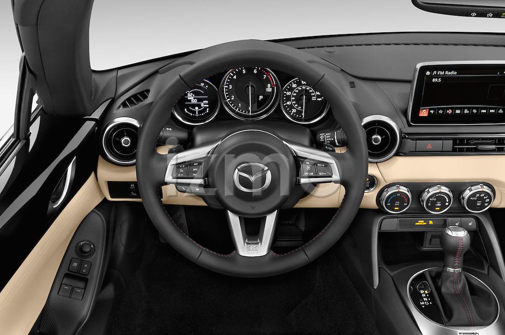 Car pictures of steering wheel view of a 2016 Mazda MX-5 Miata Grand Touring 2 Door Convertible Steering Wheel