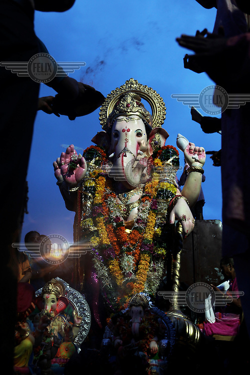 Thousands of people visit Chowpatty Beach for the culmination of Ganesh Chaturthi. This is Mumbai's biggest and most explosive celebration. Held in honor of the much-loved elephant-headed god (here called Ganpati), the 10 day festival culminates on the last day, when a jubilant procession is held and thousands of huge Ganpati idols are immersed in the sea..