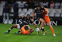 DURBAN, SOUTH AFRICA - JULY 14: Lukhanyo Am and Kobus van Wyk of the Cell C Sharks jump over Bautista Ezurra of the Jaguares during the Super Rugby match between Cell C Sharks and Jaguares at Jonsson Kings Park on July 14, 2018 in Durban, South Africa. Photo: Steve Haag / stevehaagsports.com
