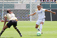 Marta #10 of the Los Angeles Sol attacks the defense of FC Gold Pride during their match at Home Depot Center on April 19, 2009 in Carson, California.