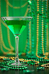 Green cocktail in martini glass with st. Patrick's day decoration