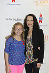 Bebe Wood & Bebe Neuwirth at the 27th Annual Broadway Flea Market & Grand Auction to benefit Broadway Cares/Equity Fights Aids in Shubert Alley, New York City, New York.  (Photo by Sue Coflin/Max Photos)