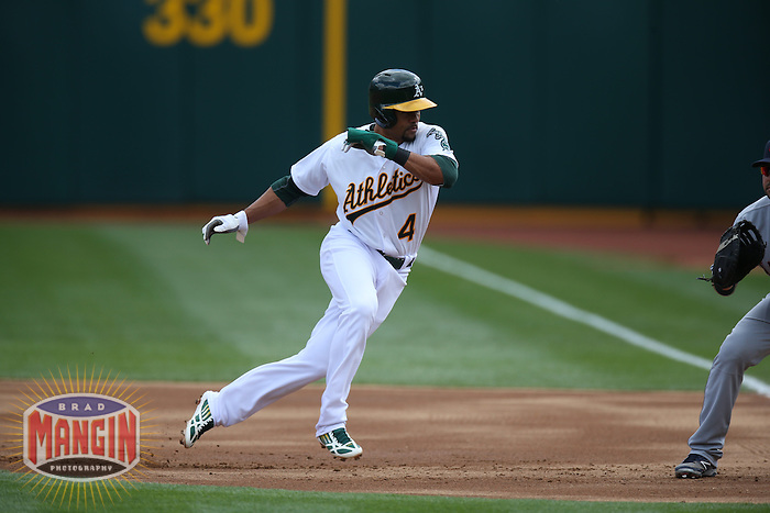 OAKLAND, CA - APRIL 2:  Coco Crisp #4 of the Oakland Athletics runs the bases against the Cleveland Indians during the game at O.co Coliseum on Wednesday, April 2, 2014 in Oakland, California. Photo by Brad Mangin