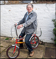 BNPS.co.uk (01202 558833)<br /> Pic: ClaireBorley/BNPS<br /> <br /> ***Must Use Full Byline***<br /> <br /> Tom with the iconic bike he designed. <br /> <br /> The original drawing designs for the Raleigh Chopper have come to light 45 years after the first ever iconic bicycle was made.<br /> <br /> The idea for the much-loved 1970s bike began as a quick doodle by inventor Tom Karen.<br /> <br /> The first scribbled sketches were just basic outlines but they clearly show its most famous features - large U-shaped handlebars and rear wheel and long leather seats.<br /> <br /> The rough sketches evolved into formal designs and Raleigh produced the first Mark I Choppers in 1969.<br /> <br /> They soon became the must-have children's item across Britain and more than 1.5 million of them were made until production ceased in 1979.<br /> <br /> The two pages of original drawings were retained by Mr Karen, now aged 87, and he took<br /> them with him when in 1999 he retired from Ogle Design, the consultancy firm used by Raleigh.<br /> <br /> Since then his sketch books have been left gathering dust in the garage of the grandfather's home in Cambridge. He has now dug them out after rediscovering them.<br /> <br /> Mr Karen said: &quot;The sketch books were just for me to do some rough doodles for me to pass on my ideas to the designers to work on and show to the client.