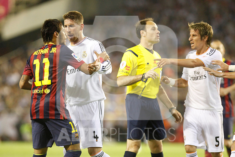 Real Madrid´s Coentrao and Sergio Ramos argue with F.C. Barcelona´s Neymar Jr during the Spanish Copa del Rey `King´s Cup´ final soccer match between Real Madrid and F.C. Barcelona at Mestalla stadium, in Valencia, Spain. April 16, 2014. (ALTERPHOTOS/Victor Blanco)