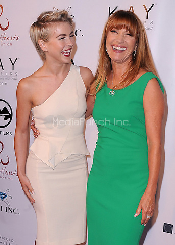 MALIBU, CA - MAY 10:  Julianne Hough and Jane Seymour at the 4th Annual Open Hearts Gala at a private residence on May 10, 2014 in Malibu, California. Credit: PGSK/MediaPunch