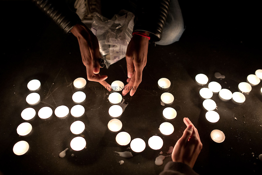 PARIS, FRANCE - NOVEMBER 14: Young people are lighting candles on the Place de la Republique in order to write the message Being Human as an answer to the attacks of November 13. The attacks of the 13th of November killed 129 people in Paris and injured 352 .
