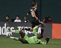Josh Wolfe (16) of D.C. United leaps over Donovan Ricketts (1) of the Los Angeles Galaxy during an MLS match at RFK Stadium, on April 9 2011, in Washington D.C.The game ended in a 1-1 tie.