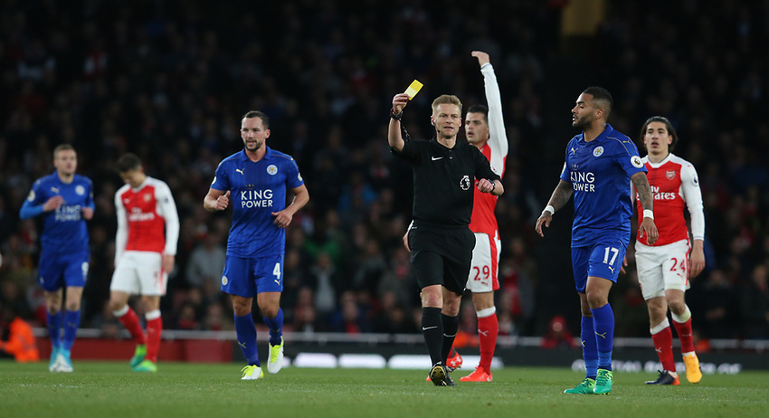 Referee Mike Jones shows a yellow card to Leicester City's Danny Simpson<br /> <br /> Photographer Stephen White/CameraSport<br /> <br /> The Premier League - Arsenal v Leicester City - Wednesday 26th April 2017 - Emirates Stadium - London<br /> <br /> World Copyright &copy; 2017 CameraSport. All rights reserved. 43 Linden Ave. Countesthorpe. Leicester. England. LE8 5PG - Tel: +44 (0) 116 277 4147 - admin@camerasport.com - www.camerasport.com