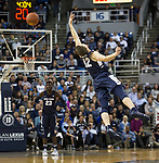 Utah State guard Justin Bean (12) can't get the high pass against Nevada in the second half of an NCAA college basketball game in Reno, Nev.,  Wednesday, Jan. 2, 2019. (AP Photo/Tom R. Smedes)