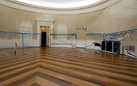 Plastic covers the walls of the Oval Office in the White House West Wing in Washington, DC as it is undergoing renovations while United States President Donald J. Trump is vacationing in Bedminster, New Jersey on Friday, August 11, 2017.  This photo is looking towards the fireplace where toe President has chairs and couches as he hosts meetings there.<br /> Credit: Ron Sachs / CNP /MediaPunch