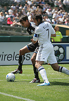 Chris Wondolowski (left) fights to maintain control against Chris Klein (7). San Jose Earthquakes defeated LA Galaxy 2-1 at the Oakland-Alameda County Coliseum in Oakland, California on June 20, 2009.